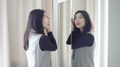 Asian portrait beautiful woman making or applying make-up Stock Footage