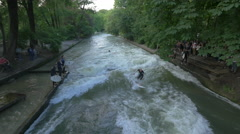 View of a man surfing on Isar River, Munich Stock Footage