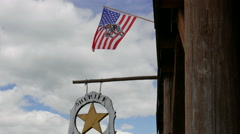 American wild west city. Sheriff office signboard Stock Footage