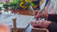 Signing marriage certificate - stock footage