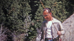 1952: Cool dad taking daughters fishing and throwing rocks. Stock Footage