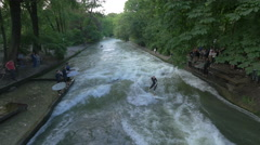 View of a man river surfing in Munich Stock Footage