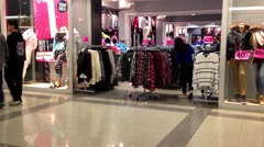 Shopper buying clothes for huge sale season Stock Footage