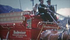 1952: Men running after Budweiser truck coming to town. Stock Footage