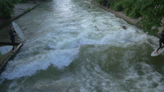 Surfing and swimming on Isar River, Munich Stock Footage