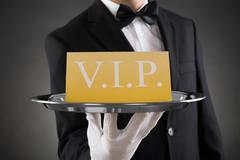 Close-up Of Waiter Showing Vip Text On Banner Stock Photos