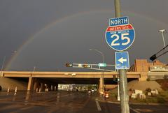 Rainbow with Highway and Interstate Sign in America - stock photo