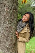 Young woman with tree Stock Photos
