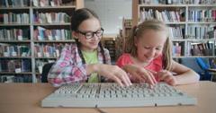 Cheerful Schoolgirls Typing Stock Footage