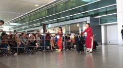 Viethamese hosteses in HCMC airport Stock Footage