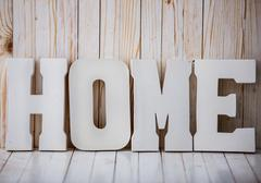 White HOME sign on wooden background - stock photo