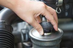 Checking for power steering oil, machine related - stock photo
