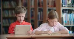 Book vs. Ebook - stock footage