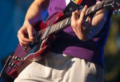 Hands of guitarist in concert Stock Photos