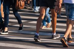 feet of pedestrians - stock photo