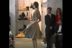 Stock Video Footage of Fashion models posing for photo shoot for Donna Karan Collection