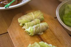 Processing to make a meat wrap in cabbage - stock photo