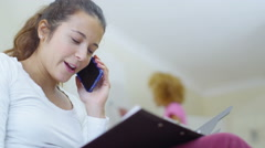 4K Gay female couple at home, woman gets good news from a phone call - stock footage