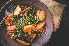 Kale and tomato stir-fry, close up - stock photo