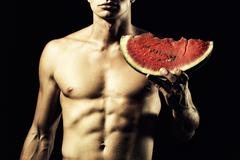 Man with water melon Stock Photos