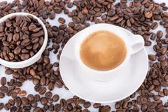 Expresso and coffee beans - stock photo