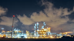Lighting from Refinery plant with blue night sky Stock Footage