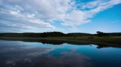 Reflection of clouds on scenic lake Stock Footage