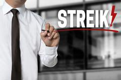 Strike is written by businessman background - stock photo