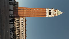 Vertical time-lapse of the tower in Saint Mark's Square as sunset shadows grow. Stock Footage