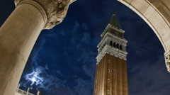 Panning time-lapse of the tower in Saint Mark's Square at night. Stock Footage