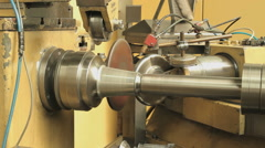 Producing round parts from steel in a heavy duty metal spinning machine - stock footage