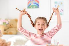 Energetic girl feeling jubilant Stock Photos