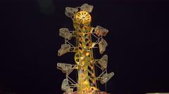 Amusement park ride at night. 4K UHD. Stock Footage