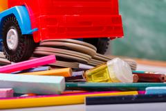 Colorful school stationary and car Stock Photos