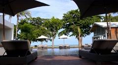 Resort Pool, Sunbed, Umbrellas near the Sea -  Luxury Vacation Stock Footage