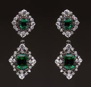 earrings with green stones on the black - stock photo