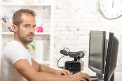 a young man video editor - stock photo