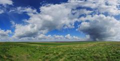 Clouds over the steppe. Stock Photos