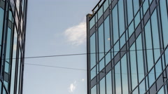 Sky framed by high-risers with glass walls, timelapse Stock Footage