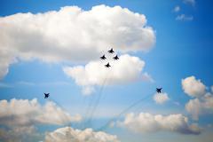 Aerobatic team performs flight maneuver Stock Photos
