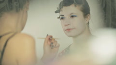 Creating the image of the heroine of comic books, drawing of eyebrows on the - stock footage
