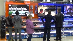 Children watching television in a shopping center. Stock Footage