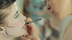 Make-up artist paints elements of the make-up on model, pop art style Stock Footage