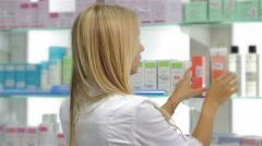 Pharmacist fronting the product in drugstore Stock Footage