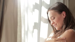 Young woman gently touching her skin, close up HD Stock Footage