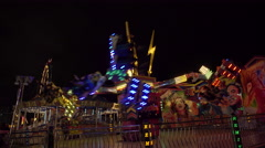 Amusement park ride at night. 4K UHD. - stock footage