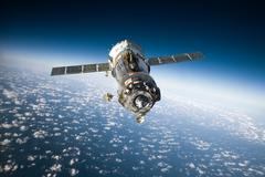 Spacecraft Soyuz over the planet earth Stock Photos