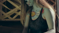 Girl in makeup of scary zombie on Halloween in the smoke Stock Footage