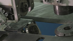 Cutting a piece of metal in a heavy duty metal processing machine - stock footage