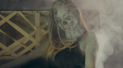 Halloween celebrating dressed as zombies in smoke - stock footage